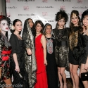 "Photographer Carrie Schechter (red dress), poses with models during the EngieStyle one year anniversary, ""A Tale of the Black Dress"", fashion presentation."