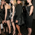 "Models pose in a black dress, during the EngieStyle one year anniversary, ""A Tale of the Black Dress"", fashion presentation."