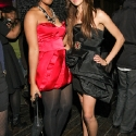 """Dominique Auxily, and Iman Hussein pose during the EngieStyle one year anniversary, """"A Tale of the Black Dress"""", fashion presentation."""